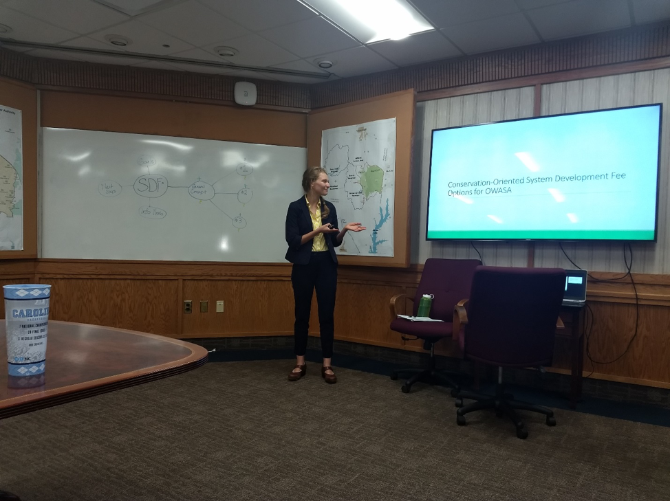 Kate Fialko presenting her research to the OWASA senior management team.