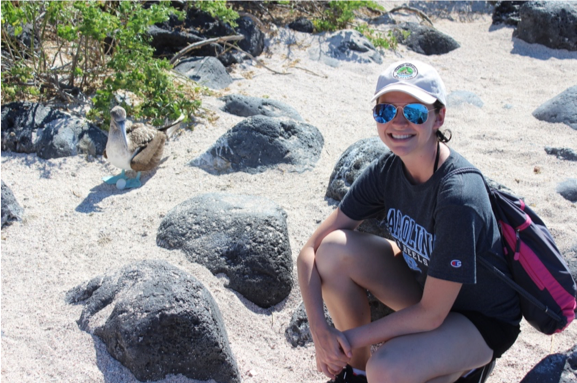Danford posing with a nesting blue-footed booby on Isla Lobos, Galápagos