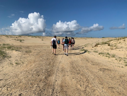 Picture of our field site hiking Jockey's ridge, where we learned about the infamous sand dunes and environmental management.